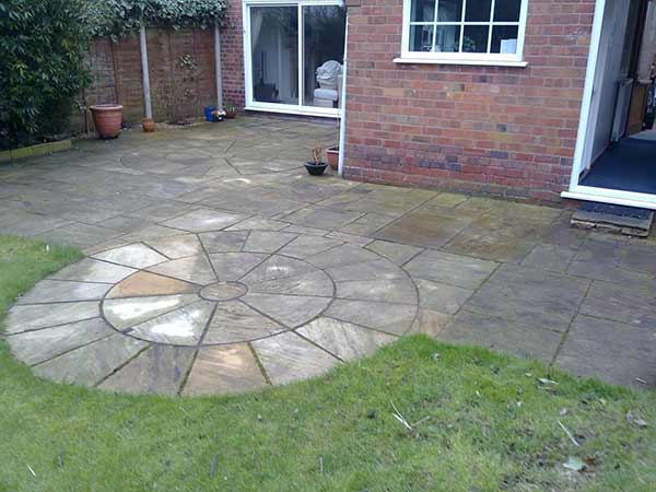 Natural stone patio before cleaning